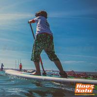 Colócate en una ligera posición de surf